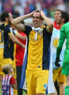 Diego Godin of Club Atletico de Madrid celebrates winning the La Liga after the match between FC Barcelona and Club Atletico de Madrid at Camp Nou on May 17, 2014 in Barcelona, Catalonia.
