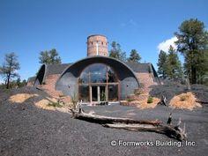 Formworks Building custom design earth-bermed houses.