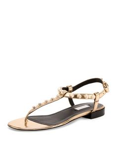 "Balenciaga mirrored metallic calfskin thong sandal with golden studs. 0.5"" flat stacked heel. T-strap vamp. Adjustable ankle strap. Lightly padded footbed. Rubber outsole. Made in Italy."