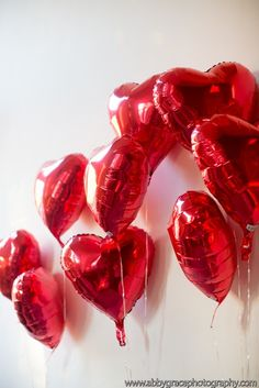Red Heart Balloons! It would be romantic to fill the room with thoses