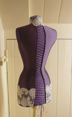 beautiful bespoke silk mannequin with corset and laced back and ivory lace panel www.corsetlacedmannequins.co.uk