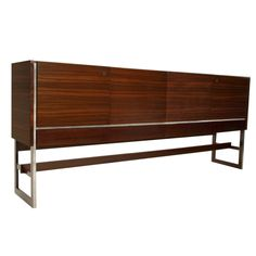 Massive Rosewood and chrome media cabinet from Denmark | From a unique collection of antique and modern cabinets at http://www.1stdibs.com/furniture/storage-case-pieces/cabinets/