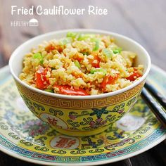 Fried Cauliflower Rice - cauliflower, coconut oil, onion, carrot, green/red bell pepper, minced garlic, minced ginger, eggs, reduced sodium soy sauce, black pepper, green onions, sesame oil