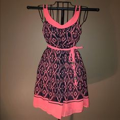Pink and black dress Cool dress with adjustable straps and braided belt. Perfect condition worn a couple times Dresses