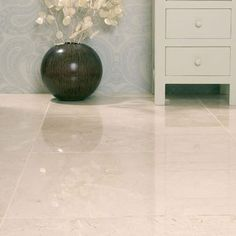 Contemporary And Modern Cream Marble Effect Highly Polished Porcelain Tiles.     These Tiles Look Just Like Marble But Without The Maintenance And A Lot More Durable