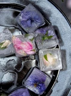 Use frozen fruit or edible florals in lieu of ice cubes for a colorful twist in your cocktail