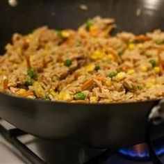 Cooked egg is shredded and mixed with a stir fry of chicken, rice and onion in soy sauce in this fundamental Chinese dish.
