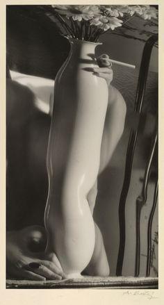 André Kertész - [Distortion: Vase with Flowers; Hand with Cigarette], c.1938.  … via The Metropolitan Museum of Art