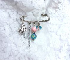 Silver safety pin brooch, butterfly charm, pink and blue murano glass beads and crystals