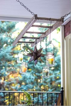 Outdoor patio ladder candle chandelier by Unskinny Boppy *Idea: Chain ladder to strong hooks in rafters. Wrap white lights around it. Wrap vined silk flowers around the light to hide wires. Hang plants from ladder rungs.
