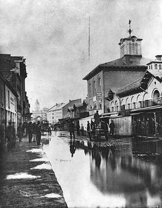 MP-0000.352 Flood in St. Anne's Market, Montreal, QC, about 1870 Alexander Henderson 1869, 19th century Notman photographic Archives - McCord Museum  MP-0000.352 Inondation au marché Sainte-Anne, Montréal, QC, vers 1870 Alexander Henderson 1869, 19e siècle Archives photographiques Notman - Musée McCord  To see the image file on the McCord Museum website, click on the following link: www.musee-mccord.qc.ca/en/collection/artifacts/MP-0000.352  Pour voir la fiche descriptive de cette…