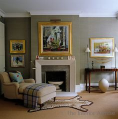 William Yeoward: The gilt-framed paintings stand out against the pale green silk wall of the living room