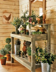 Collect containers and plop a plant or some flowers in it. That little bit of chaos is totally charming.