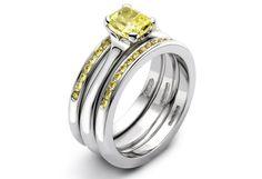 Yellow diamond platinum engagement and wedding ring set by Jon Dibben
