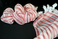 Christmas and candy canes go hand in hand. These sugary sweet candy cane door decorations made with   poly deco mesh  and a candy ...