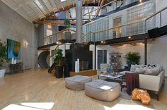 Kinda the coolest loft I've ever seen. I could rollerblade in my house (plus it has a basketball court in the living room...)