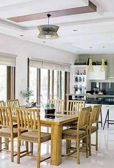 A glass-topped, eight-seater dining table sets the stage for intimate family meals for the Salazars. The modern lighting fixtures, which Jay considered to be an unusual pick at first, complements the pieces in the living, dining, and kitchen areas.