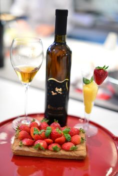 Gluten Free tart made with strawberries and custard, combined with a glass of passito wine