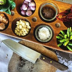 Just a handful of the fresh ingredients we used to prepare our homemade currypaste from scratch at the Smile KohMak Thai Cooking School, in Koh Mak, Thailand. The three hour class was made fun by our sweet Thai chef, Mrs Lang.