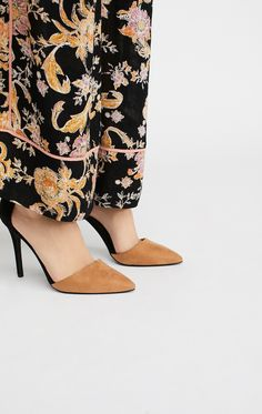 Take Two Heel   Ultra chic heels featuring an open design with a sleek pointed toe. Strap detail at the ankle has a simple hook-and-loop fastener. Padded footbed for a comfortable step.