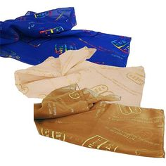 Pack of three 'Ten Commandments' scarves with the Tablet of Stone.  Made in Israel. Size: 50 x 20 inches. Colors: Blue, Cream and Gold with metallic print design.  Written in English and Hebrew. And God spoke all these words: (Exodus 20)  Shop in Jerusalem for authentic Messianic gifts direct from the Holy Land.