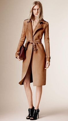 Burberry Camel Trench Coat - A straight fit trench coat in with contrast lapels. Set-in sleeves provide structure while a waist belt offers a feminine fit.