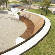 This contemporary curved bench seat in the landscape is so smart. Can you imagine relaxing and kicking back in the afternoon sun. The form would also work well with exposed aggregate concrete. If done in this treatment it would then double as a skatepark with a deck and ramp. This form would also work well in a school environment where the teacher could take an outdoor class. Critic by John Dodd L'scape Arch.
