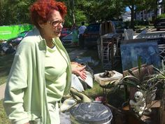 Cydney Berry surveys her possessions, many of them badly water damaged, laid out Tuesday in the front lawn of her flooded Forest Acres condo. A group of off-duty soldiers from Fort Jackson had been voluntarily helping the condo residents recover their possessions Monday and Tuesday.