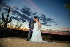 bride and groom formal portrait with light sabers at Star Wars themed wedding at Saguaro Buttes wedding venue in Tucson AZ Arizona by Michael Chansley Photography wedding photographer Tucson ideas cactus saguaro desert idea cute fun romantic letters gift pond lake sunset views couple
