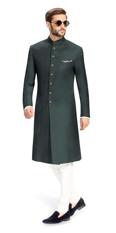 Gurhkan Racing Green This Racing Green Achkan is distinguished and elegant. It is made using fabric from Vitale Barberis Canonico. Featuring buttons that are cut from solid brass, rough buffed and plated in 24 carat gold. Indian Formal Wear, Mens Indian Wear, Indian Groom Wear, Indian Men Fashion, Mens Fashion Suits, Wedding Dresses Men Indian, Wedding Dress Men, Men Wedding Fashion, Sherwani Groom