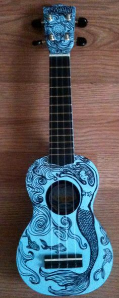 Mermaid Ukulele. If I ever get really good at it I want to get one like this.