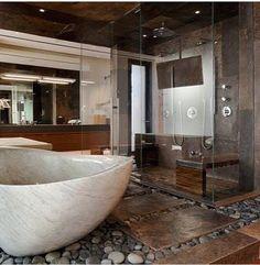 This open bathroom in a home in Las Vegas uses a pleasing mixture of stone, glass and wood. Open Bathroom, Master Bathroom, Bathroom Ideas, Bathroom Designs, Brown Bathroom, Bathroom Showers, River Rock Bathroom, Las Vegas, House Seasons