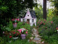 A backyard cottage suitable for Snow White, Marie Antoinette, or Barbie. Cathy Scalise's oasis of opulence and whimsy appeals to hopeless romantics.