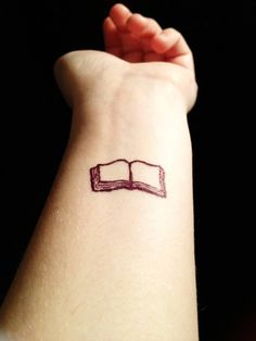 Book tattoo :) It'd be cooler with words on the pages, but it's still pretty cool.