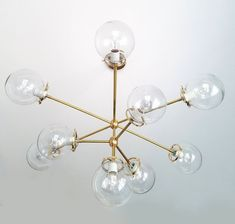 With its ten hand-blown glass globes, the Stella! chandelier is bound to make a… Dining Light Fixtures, Chandelier Lighting Fixtures, Dining Lighting, Sputnik Chandelier, Living Room Lighting, Modern Lighting, Lighting Design, Pendant Lighting, Copper Lighting