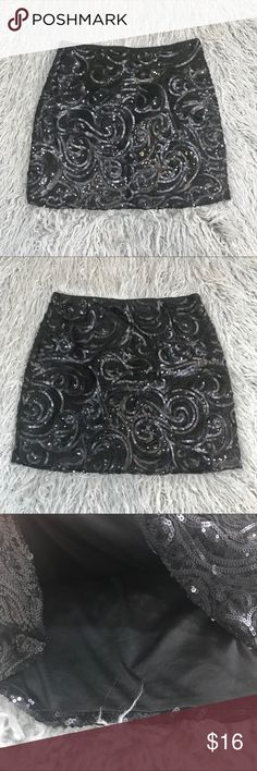 "UO Silence + Noise Sequin Sparkle Mini Skirt In excellent used condition. Black sequin pattern throughout. No stretch. Size 2, Please refer to measurements to ensure a proper fit.   Waist: 13"" Length: 15"" Urban Outfitters Skirts Mini"