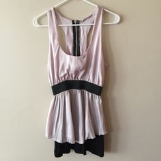 Julies Closet size Medium light pink/black top Size Medium light pink and black top in size Medium. Worn once. Small snag in front as shown in picture. Hardly noticeable. Julies Closet Tops