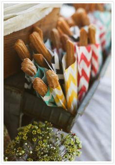 Obviously we are going to have to have some yummy churro snacks around considering we will be serving Mexican food (duh, Gio is Mexican and I'm absolutely in love with the stuff!). I like these bright chevron pattern holders for them, I'd just pick a few different colors.