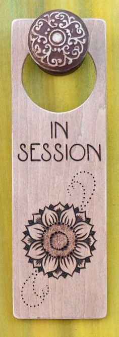 https://www.etsy.com/shop/DesignsByHeidiLynne Wood-burned door hanger sign with sunflower, In Session door sign for therapy or spa.