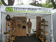 We debuted our new art fair booth last weekend at the Spring Green Art and Craft Fair. We thought our old booth was a little too deep and. Craft Show Booths, Craft Fair Displays, Craft Show Ideas, Display Ideas, Booth Displays, Booth Ideas, Craft Font, Wall Boxes, Plate Display