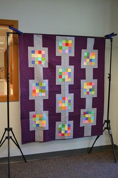 Like the gray and the colorful tiny squares, but not the purple.