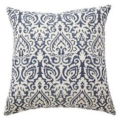 Add a dash of pattern to a neutral-toned sofa or loveseat with this eye-catching pillow, featuring a bold floral motif.