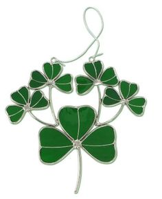 """Shamrock Stained Glass Suncatcher by DM Merchandising. $12.50. Approximately 6 1/4"""" wide and 6"""" tall.. Green glass with silver colored metal.. Makes a great gift or housewarming present!. Shamrock shaped suncatcher. Green and silver colored Shamrock Suncatcher features a large shamrock with 4 smaller shamrocks growing"""" from it. Makes a great gift!"""""""