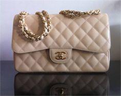 Chanel classic flap beige handbag