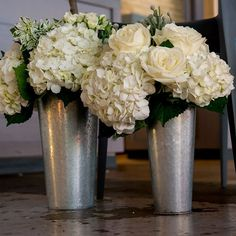 These delightful galvanized market buckets are ideal for creating elegant arrangements using long-stemmed flowers. The wood-accented handle adds a nice, natural detail and the cool, pewter grey of the
