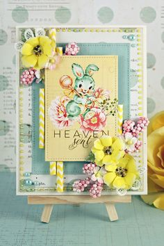 """""""I loved using the new Tropicalia flowers from the Prima Summer 2016 collection.  I used the beautiful, bright yellow color for inspiration as I created this card using the Heaven Sent collection.  These flowers are trimmed in white which gives them a soft appearance, just perfect to welcome baby."""" ~ Robin Shakoor"""