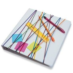 Rubber bands stretched over a notebook cover to hold pens and other small items. Brilliant! Doing this for my middle schooler's binders!