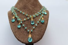 Apatite triple strand wire wrapped necklace with vermeil and suede.