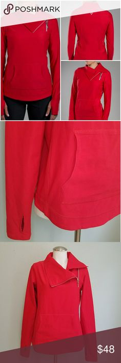 """Jofit Jumper Jacket Pullover in Lipstick Red Really cute 1/4 zip pullover with fun folding collar and angled zipper. Such a beautiful jacket! Thicker material that is quality constructed. Comparable to Patagonia or Marmot quality! Front kangroo pocket. Thumb joles in sleeves. Lipstick red color. Still for sale on their website for $66. Retail $132. Size Medium. No signs of wear. Absolutely perfect condition. 27 1/4"""" sleeves. 19.5"""" bust. 21"""" hem at hips. 25 1/4"""" from neck to back hem. 80%…"""