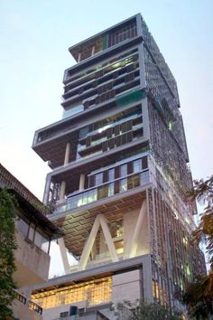 Indian billionaire Mukesh Ambani's 1 Bil dollar skyscraper family residence Antilia Mumbai. All 22-storeys with double height ceilings completely reserved for the Ambani's family
